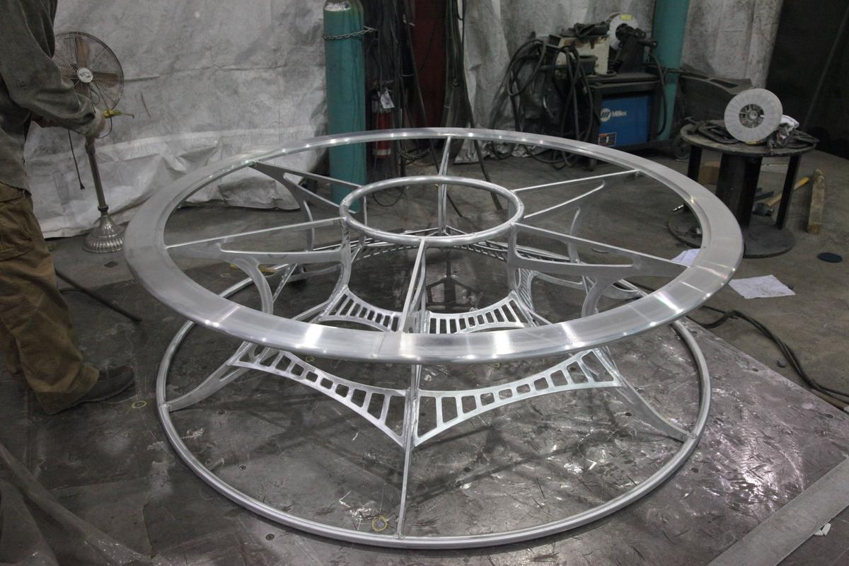 Contortionist aluminum table